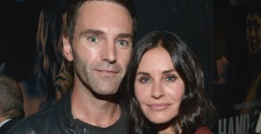 "LOS ANGELES, CA - AUGUST 19:  Musician Johnny McDaid (L) and actress Courteney Cox attend the Amazon premiere screening for original drama series ""Hand Of God"" at The Theatre at Ace Hotel on August 19, 2015 in Los Angeles, California.  (Photo by C for Amazon Studios)"
